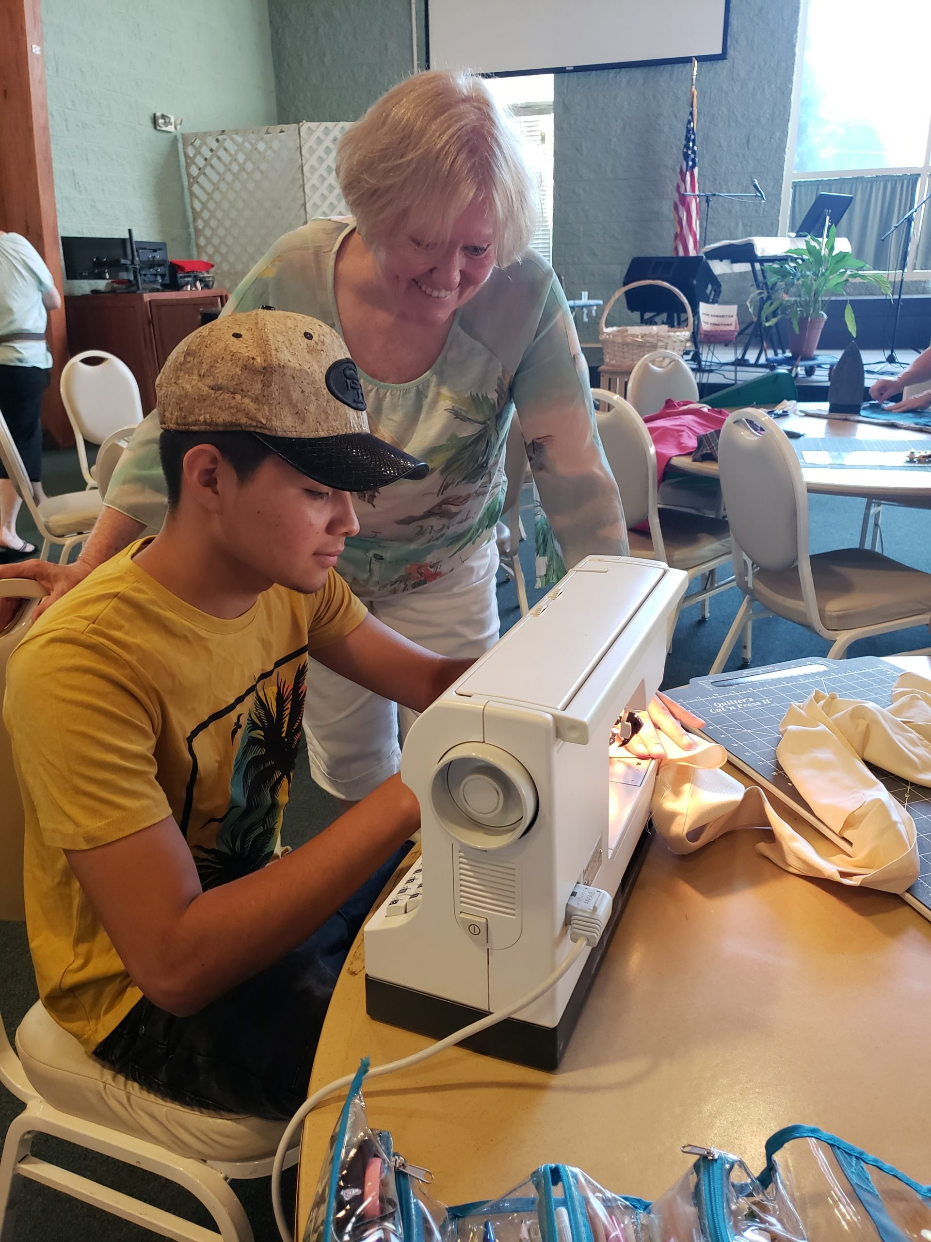 A student and teacher work together to make an apron during Summer Fest 2019.