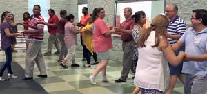 Teachers from Sanford Latin Dance LLC, instruct EL Refugio students, staff and Jonesboro UMC members how to dance salsa. Oscar Hernandez, far right, takes part.