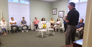 Sanford Mayor Chet Mann, standing, and local real estate agents offer a class on first-time home buying to English as a Second Language students and instructors at Summer Fest 2019.
