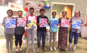 Artist Janice Heller, right, and students display their artwork at Summer Fest 2019.